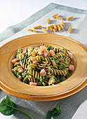Whole grain fusilli with trout, spinach and pink pepper