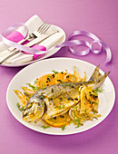 Sea bream with saffron and orange vinaigrette on orange and fennel
