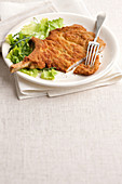 Wiener Schnitzel (breaded veal escalope) with salad
