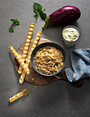 Eggplant and mint dip with breadsticks