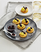 Choux pastry rings with vanilla cream and amarena cherries