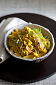 Ziti with saffron infused grasshopper, artichokes and almonds