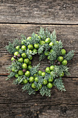 Wintry wreath with Brussels sprouts and cypress branches
