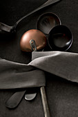 Ladles and gray kitchen towel