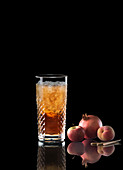 An iced tea in a tumbler against a black background