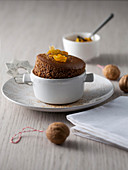 Spice chocolate soufflé with kumquat compote