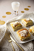 Stockfish sandwiches au gratin with bechamel sauce and parmesan