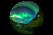 Aurora borealis over cliffs in Iceland, full-dome image