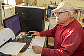 Dairy farmer reviewing data
