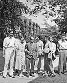 George Uhlenbeck, Enrico Fermi, physicists, with others