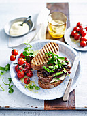 Steak sandwich with roasted cherry tomatoes