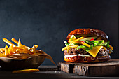 Burger with mango and avocado, served with fries