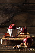 Christmas apples with caramel sauce and nuts