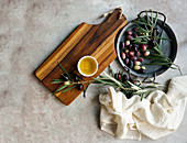 Olive tree branch, napkin, olive oil