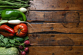 Fresh organic vegetables on a dark wooden table