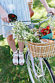 Bike and basket with flowers and strawberries