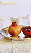 Name card held by pomegranate