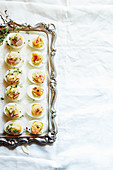 Stuffed eggs on a silver platter