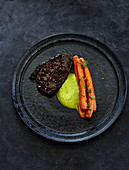 Braised beef rump with carrots and a lovage sauce