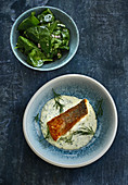 Fried whitefish fillet with spinach salad and dill hollandaise