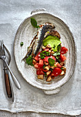 Baked anchovies with a tomato and bread salad and green mayonnaise