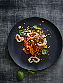Baked calamaretti with tomato pasta