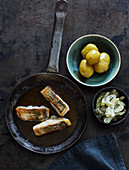 Fried zander fillet with mustard gherkins and new potatoes