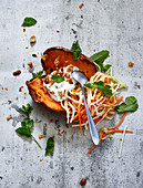 Stuffed roast sweet potatoes with sour vegetables and herb quark