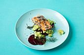 Salmon fillet on beetroot carpaccio and avocado cream (keto cuisine)