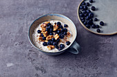 Muesli with coarse cream cheese, blueberries and almond milk