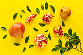 Fresh seasonal pomegranate from above on yellow background