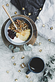 Smoothie bowl on wooden board with cup of tea