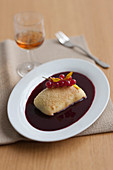 Semolina and poppyseed strudel with redcurrant sauce