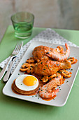 Pollo alla marengo (chicken with tomatoes, prawns and egg, Italy)
