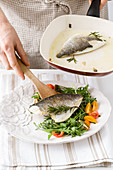 Gilt-head bream on a rocket salad