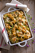 Pasta gratin with veal ragout and courgette