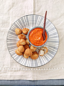 Akara (fried bean balls with chilli sauce, West Africa)