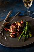 Roasted lemon rabbit with dried tomatoes and green asparagus