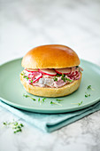 A Swedish burger with soused herring, apples and rhubarb