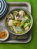 Thai glass noodle soup with mushrooms and meatballs