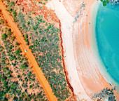 Orange sand and turquoise ocean water, Crab Creek Road, Broome, Kimberley, Western Australia