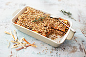 Bake with buckwheat, root vegetables and pecan-parmesan crust