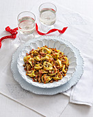 Veal tortellini with raisins