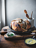 Whole salt-baked pumpkin with raclette cheese sauce