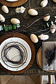 Easter table set in shades of brown decorated with birch twigs