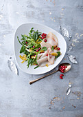Smoked fish salad with puntarelle, chicory, redcurrants and candied orange zest
