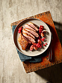 Duck breast in Barolo sauce with redcurrants and cardamom