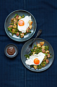 Sausage and kale hash with fried eggs