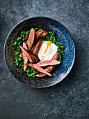 Wild boar fillet with spinach and a poached egg