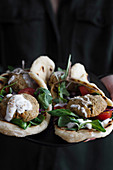Falafel and fresh vegetables in pita bread on plate for eating vegetarian healthy food